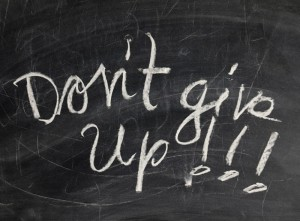 Dont give up written on a blackboard
