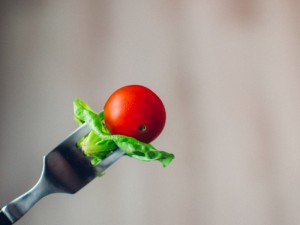 Tomato on a fork ready to be eaten