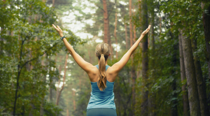 woman exercising in the woods