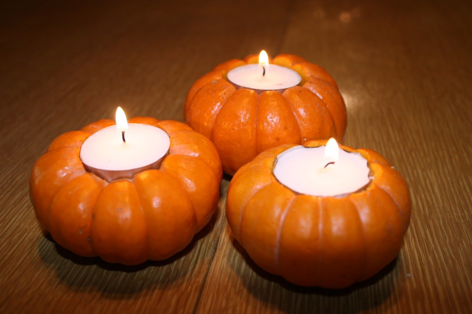 three-small-pumpkin-as-candle-holder-thanksgiving-diy-decor-wooden-table-thanksgiving-diy-decor-decorating-fabulous-thanksgiving-diy-decor-inspiration