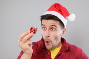 Man excited about his joke christmas present from his stocking