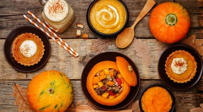 Variety of pumpkin based food on table
