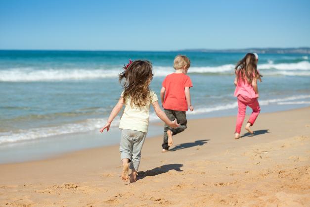 kids running along the beach