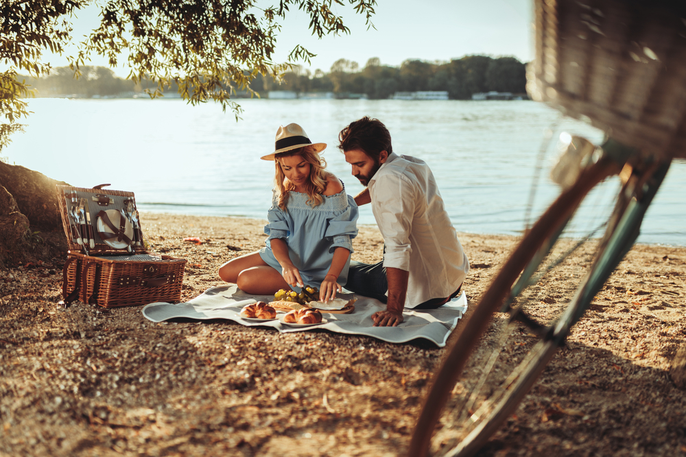Couple on picnic by lake